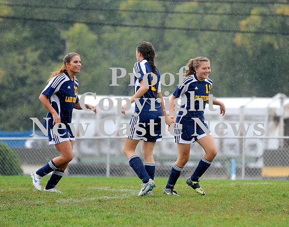 Courtney Caughey-Stambul/NEWS<br /> Wilmington players celebrate after scoring a goal against West Middlesex. From left: Kyndra Chambers, Rachael Huff and Anna Hartwell.