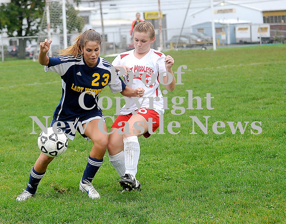 Courtney Caughey-Stambul/NEWS<br /> Wilmington's Kyndra Chambers fights for possession of the soccer ball yesterday against West Middlesex's Corinn Stonebraker.