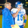 Erica Galvin/NEWS<br /> Head Coach Don Phillips talks with quarterback Justin Vetica during a timeout.