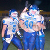 Erica Galvin/NEWS<br /> Jared Meyers (5) along with his other teammates celebrate with Beau Ewing (40) after Ewing scored a touchdown in the fourth quarter against Riverside.