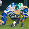 Erica Galvin/NEWS<br /> Ellwood City's John Baldelli (22) and Dillon Horgan (7) tackle Riverside's John Abmayer.