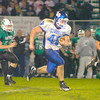 Erica Galvin/NEWS<br /> Ellwood City running back Beau Ewing splits the Riverside defense during a big gain in the third quarter.