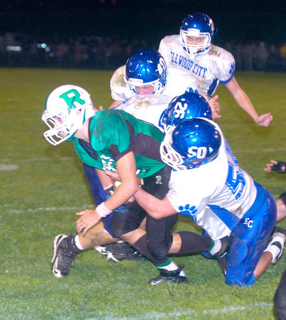 Erica Galvin/NEWS<br /> The Ellwood City defense led by Trent Viccari (50) and Christopher Shurtz (26) tackle Riverside running back Brent Mulneix.