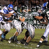 Courtney Caughey-Stambul/NEWS<br /> Laurel's Dalton Rosta fights for yards against Union's Tre Major, left.