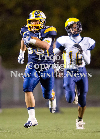 Wilmington fullback Tyler Donati (33) escapes a Saegertown defender in the second quarter Friday.