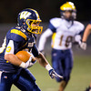 Wilmington fullback Tyler Donati (33) runs the ball past Saegertown defenders in the second quarter of Friday night's matchup.