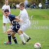Courtney Caughey-Stambul/NEWS<br /> Wilmington's Ryan DiLullo battles Slippery Rock's Marty Doyle to get to the soccer ball yesterday.