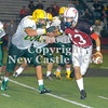 Erica Galvin/NEWS<br /> New Castle quarterback Julian Cox tries to outrun Blackhawk defender, Andrew Podbielski in the fourth quarter.