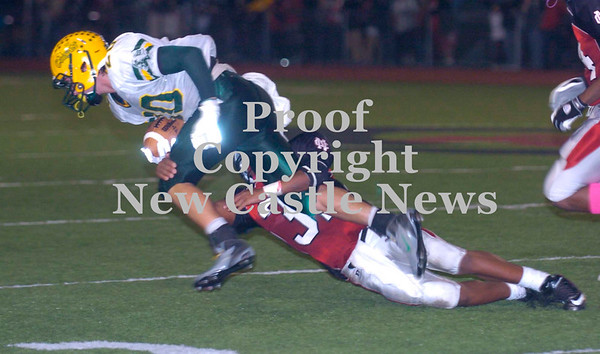 Erica Galvin/NEWS<br /> New Castle Tevin McCaster tackle's wide receiver Alex Caratelli in the second quarter.