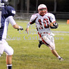 Courtney Caughey-Stambul/NEWS<br /> Neshannock quarterback Ernie Burkes runs the football against Rochester.