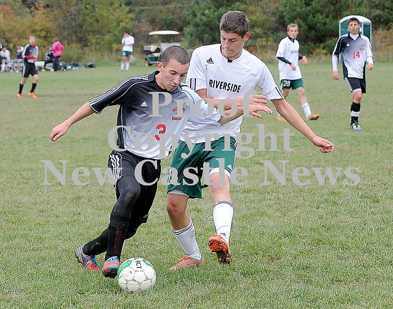 Courtney Caughey-Stambul/NEWS<br /> Mohawk's Matt Aeppli advances the ball under pressure from Riverside's Caleb LaDuke.