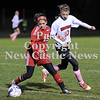 Courtney Caughey-Stambul/NEWS<br /> Neshannock's Angela DeBlasio battles against Mohawk's Melissa Verlotte to maintain possession of the soccer ball last night.