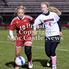 Courtney Caughey-Stambul/NEWS<br /> Neshannock's Kelly Cournan and Mohawk's Mackenzie Moon race after the soccer ball last night.