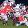 Erica Galvin/NEWS<br /> Mohawk's Chase Miller, left, and Shane McFarland tackle's the Bobcat's  Darian Bradley in the first quarter.