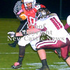 Erica Galvin/NEWS<br /> Saivon Watt runs the ball as Beaver's Dylan Goff (11) attempts the tackle.