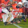 Erica Galvin/NEWS<br /> Shane McFarland fights for extra yardage.