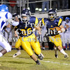 Courtney Caughey-Stambul/NEWS<br /> Tyler Welsh runs the football for the Wildcats.