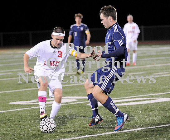 Courtney Caughey-Stambul/NEWS<br /> Neshannock's Clay Kemerer protects the soccer ball last night under pressure from a Central Valley player.
