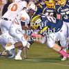 Erica Galvin/NEWS<br /> Wilmington's Jeremy Miller tackles Sharon's Michael Bonner in the second quarter.