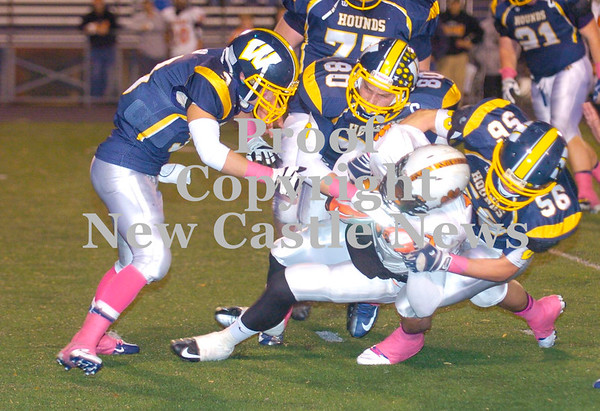 Erica Galvin/NEWS<br /> Wilmington defenders from left, Nic Pugh, Donnie Watson and Xavier Coulter tackle Sharon quarterback Jesse Rodgers in the second quarter.