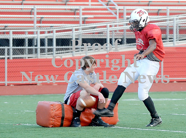Courtney Caughey-Stambul/NEWS<br /> New Castle's Khalil Huddleston practices kicking the football on Monday.