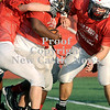 Courtney Caughey-Stambul/NEWS<br /> New Castle Jalen Holmes runs the football in practice on Monday.
