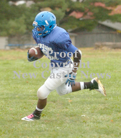 Erica Galvin/NEWS<br /> Drew Robinson runs the football during practice.
