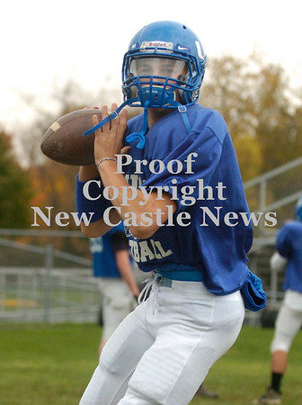 Erica Galvin/NEWS<br /> Union quarterback Joe Salmen looks down field to throw a pass to a teammate during practice.