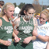 Erica Galvin/NEWS<br /> Laurel teammates help Brooke Dicks, center, to keep moving after finishing the race.