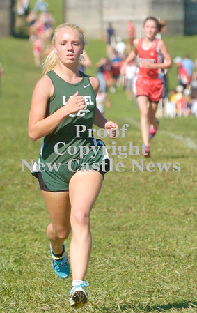Erica Galvin/NEWS<br /> Laurel's Alison Filer makes her way across the finish line.