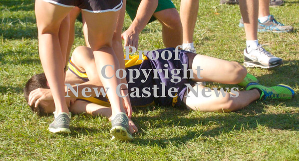 Erica Galvin/NEWS<br /> Shenango's Andy McCann collapses after crossing the finish line.