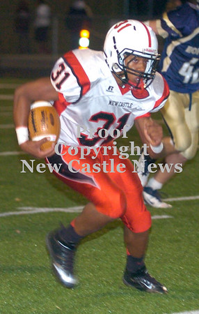 Erica Galvin/NEWS<br /> Tevin McCaster runs for yardage in the second half.