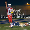 Erica Galvin/NEWS<br /> New Castle quarterback Julian Cox avoids Hopewell's Tyler Ishman's tackle as he passes downfield.