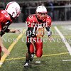 Courtney Caughey-Stambul/NEWS<br /> Neshannock quarterback Ernie Burkes flips the ball to running back Eli Owens.