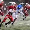 Courtney Caughey-Stambul/NEWS<br /> Mike Rodriguez picks up yardage for Neshannock as Union's Tre Major closes in for the tackle.