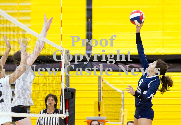 Scott R. Galvin / NEWS<br /> Shenango's Irene Koury tips the ball over the net during the third set against West Shamokin in the WPIAL girls volleyball playoffs at North Allegheny High School yesterday.