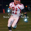 Erica Galvin/NEWS<br /> John Conglose returns a punt in the first quarter.