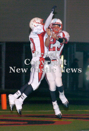Erica Galvin/NEWS<br /> Ernie Burkes and Eli Owens celebrate after a Burkes touchdown in the second quarter.