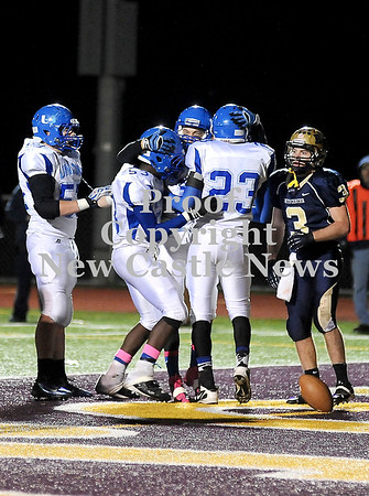 Courtney Caughey-Stambul/NEWS<br /> Union quarterback Joe Salmen, center, celebrates with teammates, Dakota Cameron, left, Malik Williams and Tre Major, right, after scoring a touchdown last night.