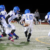 Courtney Caughey-Stambul/NEWS<br /> Union quarterback Joe Salem hands off the football to running back Drew Robinson, right, last night against Beth-Center.