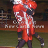 Erica Galvin/NEWS<br /> John Conglose and Steven Jeffries celebrate after a touchdown in the third quarter.