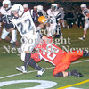 Erica Galvin/NEWS<br /> Neshannock's Alex Welker tackle's Justice Rawlins  in the first quarter.