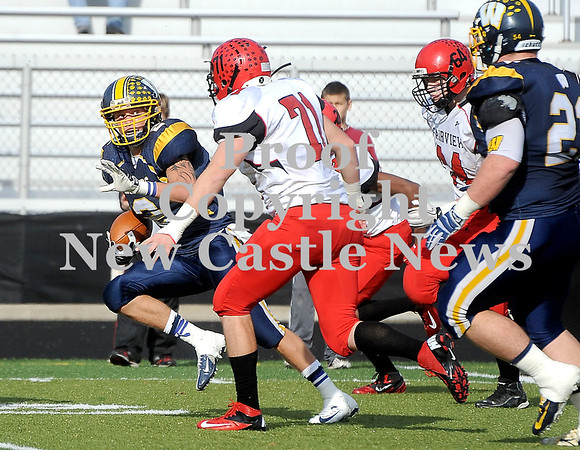 Courtney Caughey-Stambul/NEWS<br /> Wilmington's Alex Patton runs the football as Fairview's Brandon Locke closes in for the tackle.