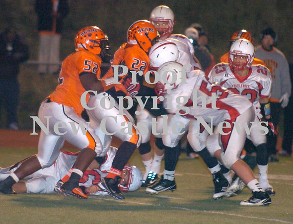 Erica Galvin/NEWS<br /> The Neshannock defense pushes back Clairton's fullback Brandon Murphy in the second half.