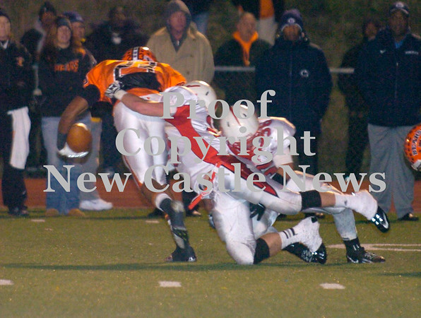 Erica Galvin/NEWS<br /> Neshannock's Alex Welker and Kienan Owens tackles Clairton running back Tyler Boyd.