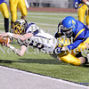 Courtney Caughey-Stambul/NEWS<br /> Wilmington quarterback Cody Llewellyn dives into the endzone to score a touchdown for the Greyhounds in double overtime.