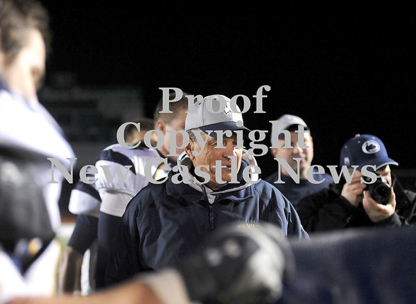 """Courtney Caughey-Stambul/NEWS<br /> Wilmington coach Terry Verrelli reacts as his players present him with a banner that reads, """"District 10 Winningest Coach"""" following Saturday night's victory over Greenville."""