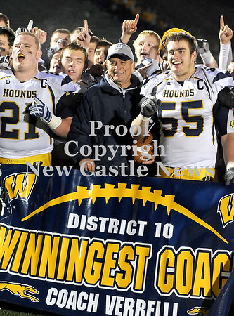 Courtney Caughey-Stambul/NEWS<br /> Wilmington coach Terry Verrelli smiles while surrounded by his players after becoming District 10's winningest coach following Saturday night's victory over Greenville.