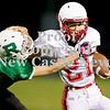 Scott R. Galvin / NEWS<br /> Neshannock's Jonathan Krueger (21) sheds a tackle by Riverside's Dylan Shannon in the third quarter of the junior high football championship on Thursday.  RIverside won 59-6 and went undefeated for the season.
