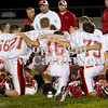 Scott R. Galvin / NEWS<br /> Neshannock players Jonathan Krueger (21), Alex Brown (16), and William Presnar (75) embrace following the team's 59-6 loss to Riverside during the junior high football championship on Thursday.